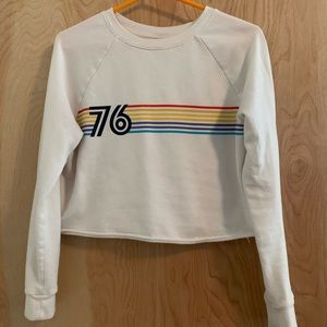 Cropped sweater with colored stripes